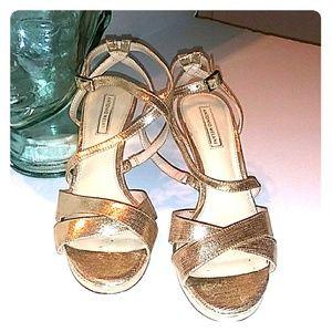 Antonio Melani gold heels.